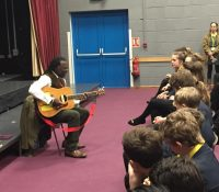 Levi Roots's inspirational tale dished up to keen Brighton Hill students